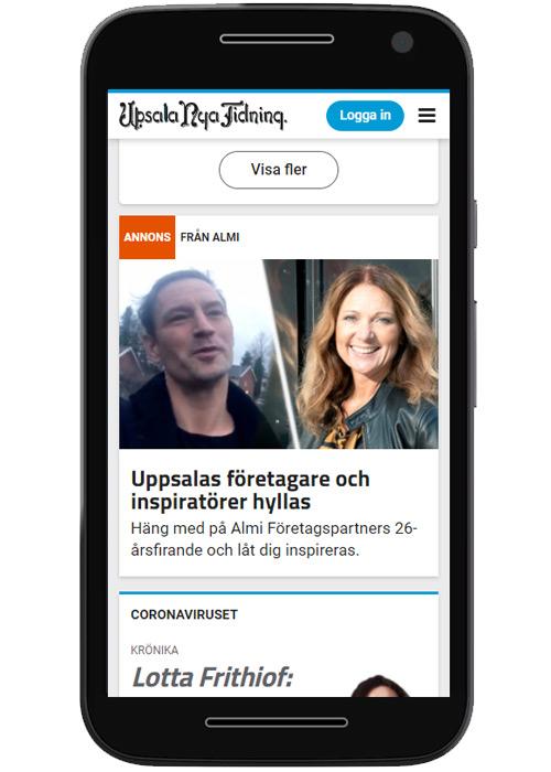 Telefon ståendes som visar en annons